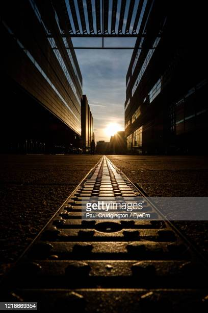 low angle view of walkway in city against sky - direction stock pictures, royalty-free photos & images