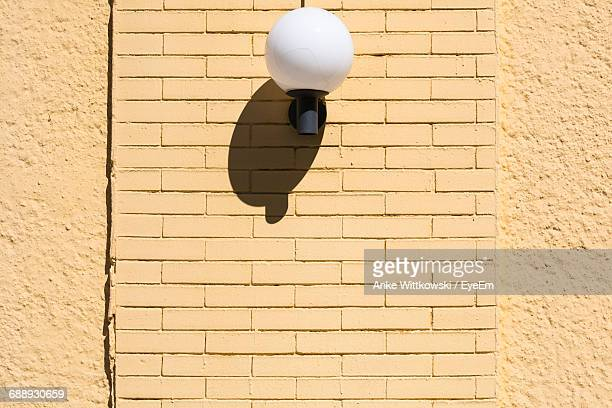 Low Angle View Of Wall Lamp With Shadow