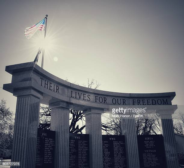 low angle view of war memorial against sky - patriotism stock photos and pictures
