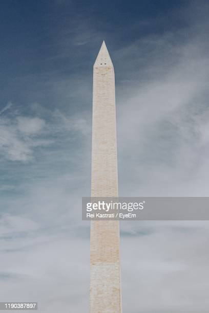 low angle view of washington monument against cloudy sky - war memorial stock pictures, royalty-free photos & images