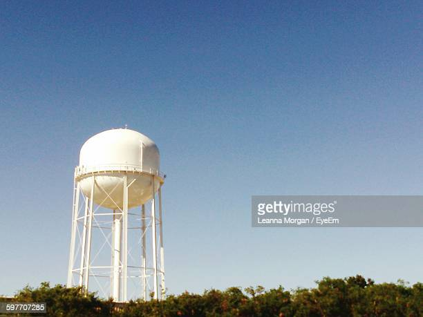 low angle view of water tower against clear sky - water tower storage tank stock pictures, royalty-free photos & images
