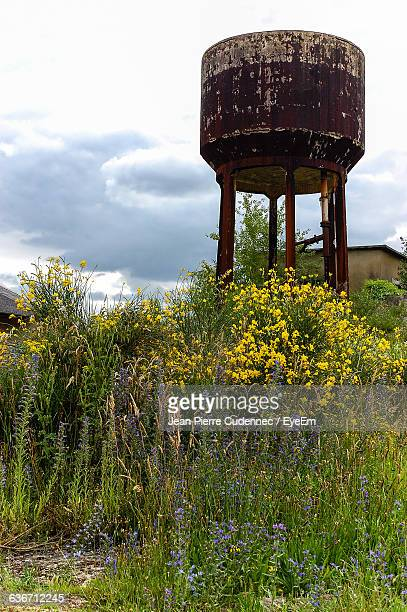Low Angle View Of Water Tower On Field Against Sky
