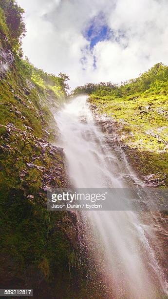 Low Angle View Of Waterfall Against Sky