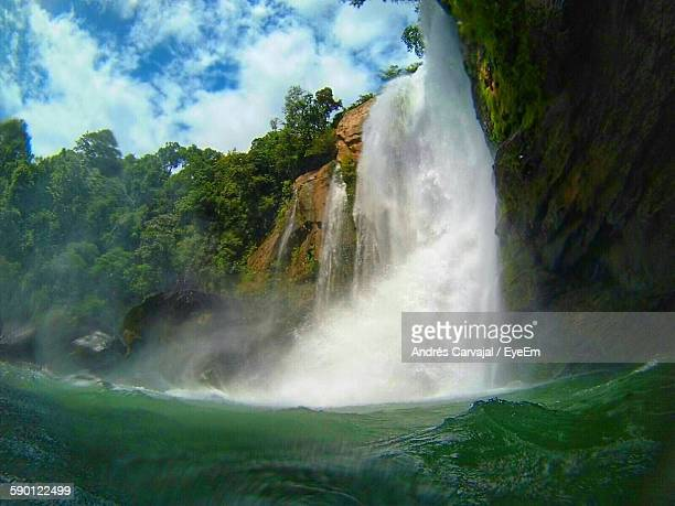 low angle view of waterfall against sky - carvajal stock photos and pictures