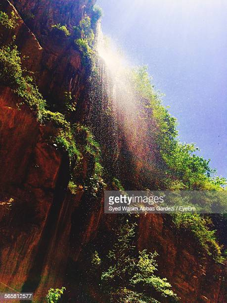 Low Angle View Of Waterfall In Bright Sunlight