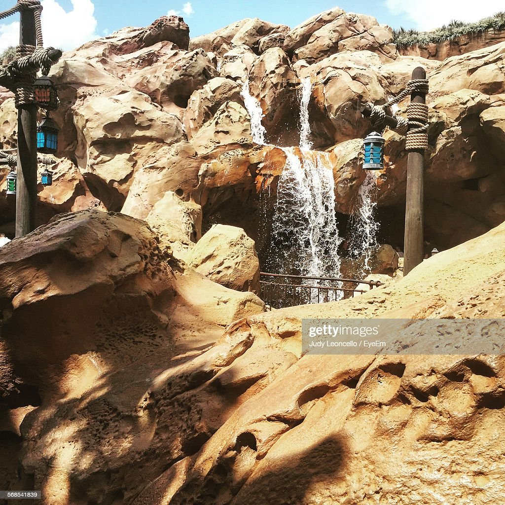 Low Angle View Of Waterfall On Rocky Mountains : Stock Photo