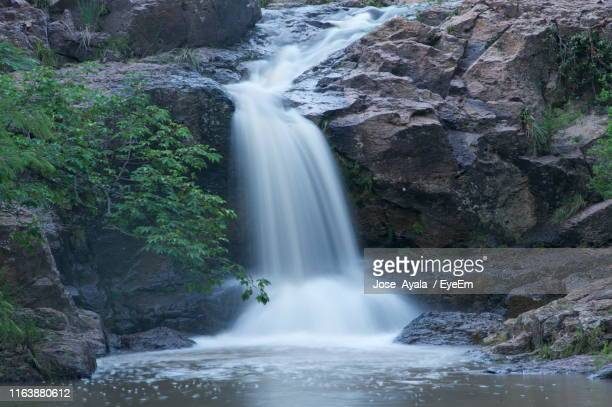 low angle view of waterfall - jose ayala stock pictures, royalty-free photos & images