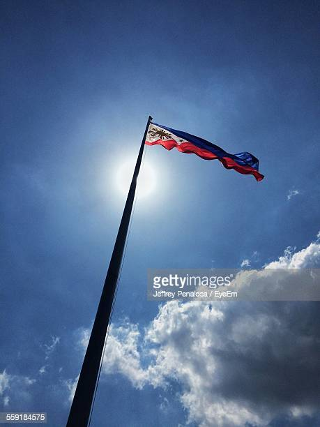 low angle view of waving flag of philippines - philippines flag stock pictures, royalty-free photos & images