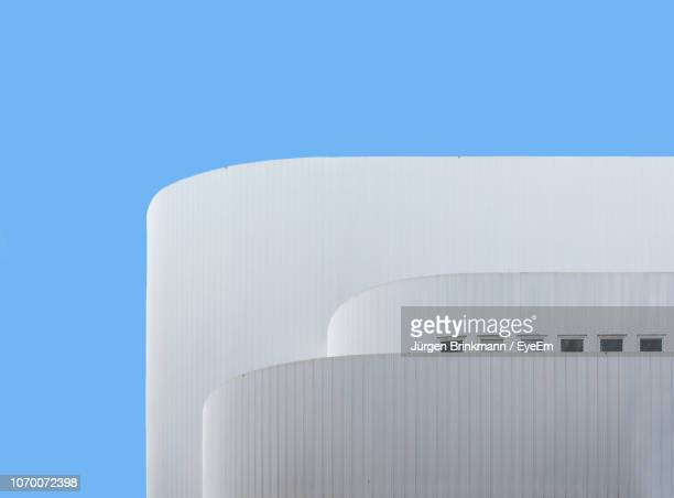 low angle view of white building against clear blue sky - düsseldorf stock pictures, royalty-free photos & images