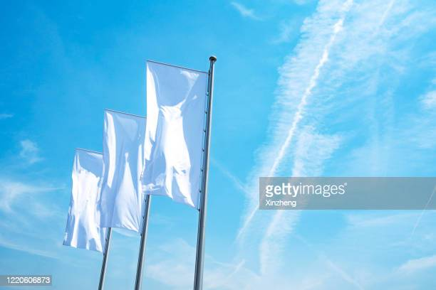 low angle view of white flag - pole stock pictures, royalty-free photos & images
