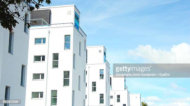 Low Angle View Of White New Apartment Buildings Against Sky