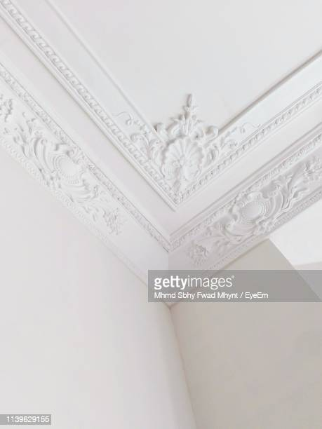 low angle view of white patterned ceiling - ceiling stock pictures, royalty-free photos & images