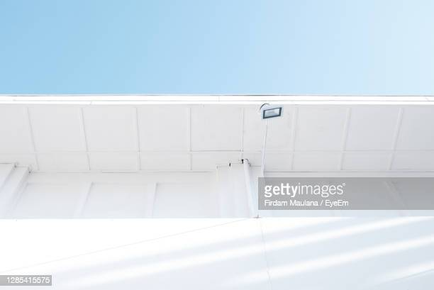 low angle view of white wall against clear blue sky - blue angels stock pictures, royalty-free photos & images