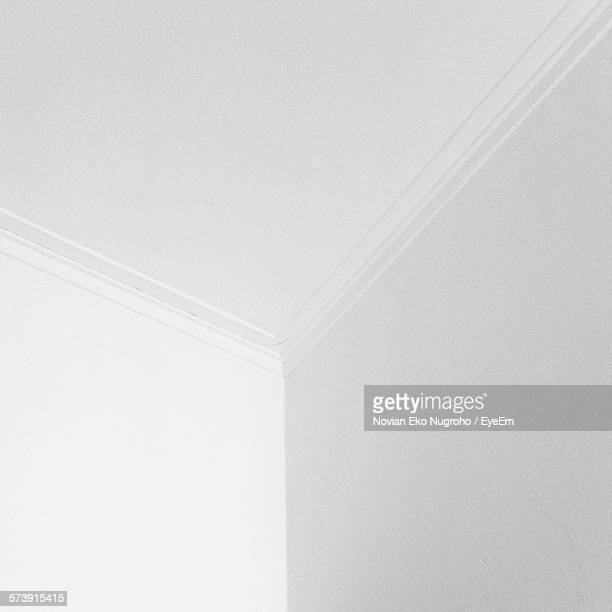 low angle view of white walls and ceiling of a room - ceiling stock pictures, royalty-free photos & images
