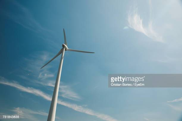 low angle view of wind turbine against blue sky - bortes ストックフォトと画像