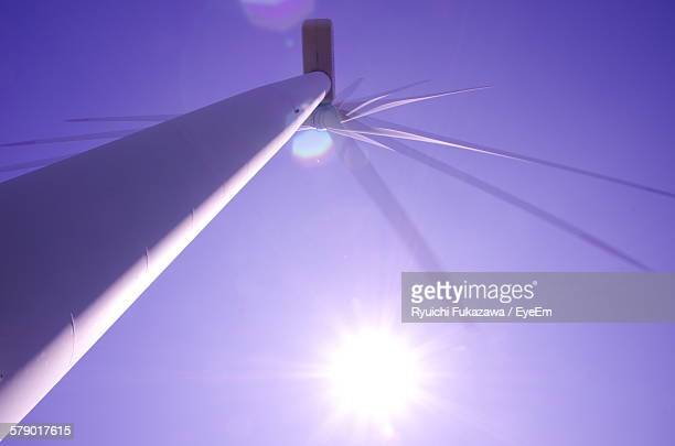 Low Angle View Of Windmill Against Bright Sun