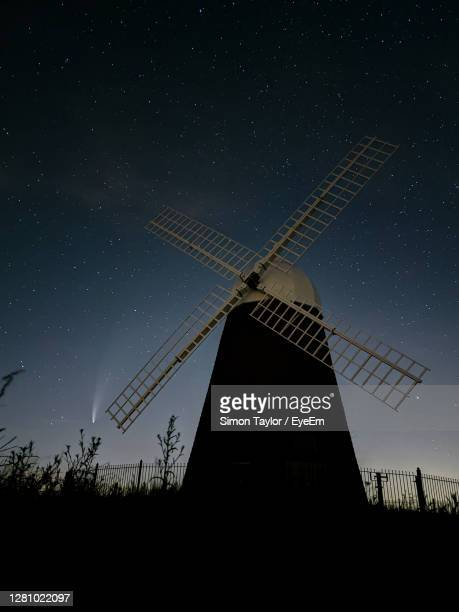 low angle view of windmill against sky at night - chichester stock pictures, royalty-free photos & images