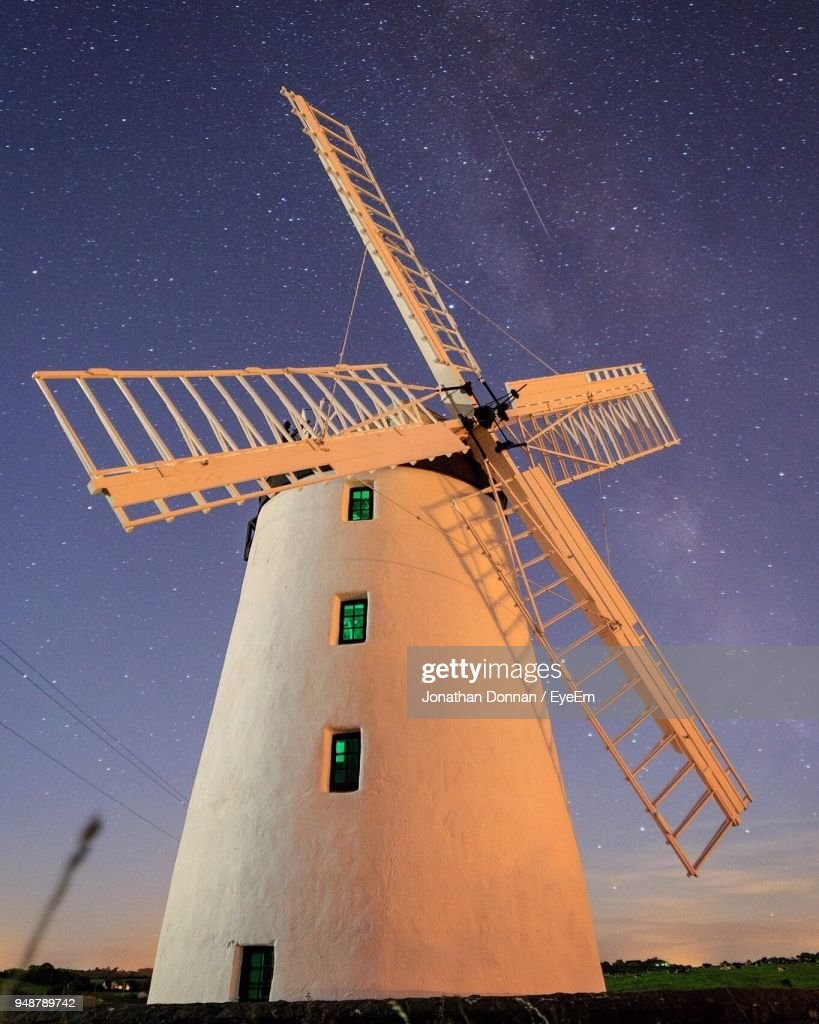 Low Angle View Of Windmill Against Sky At Night : Stock Photo