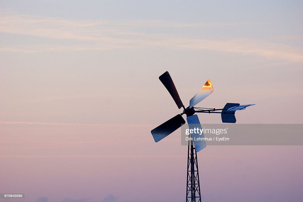Low Angle View Of Windmill Against Sky During Sunset : Stock Photo