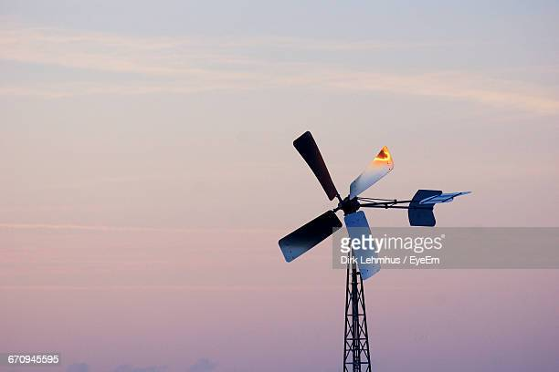 Low Angle View Of Windmill Against Sky During Sunset