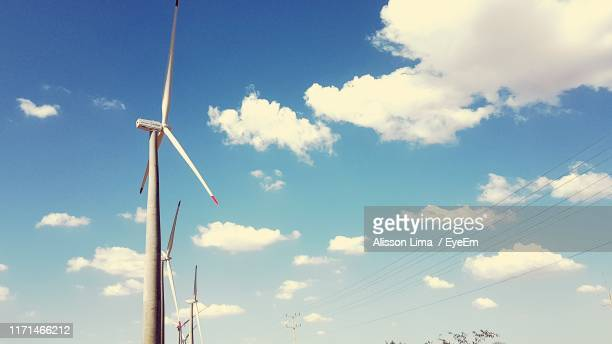 low angle view of windmill against sky - alisson stock pictures, royalty-free photos & images