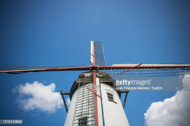 low angle view of windmill against sky - damme stock pictures, royalty-free photos & images