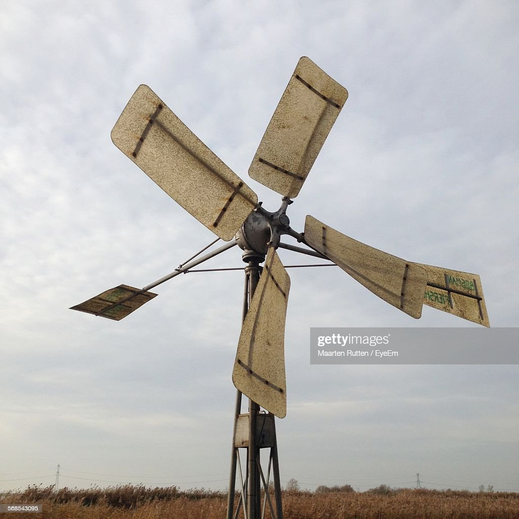 Low Angle View Of Windmill On Field Against Sky : Stock Photo