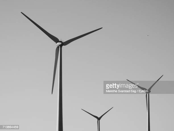 Low Angle View Of Windmills Against Clear Sky