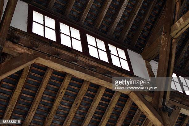 low angle view of window by wooden ceiling - olivier schittenhelm photos et images de collection