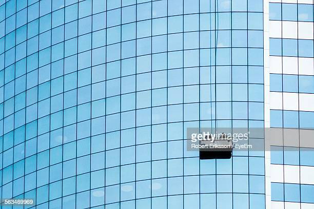 Low Angle View Of Window Cleaners