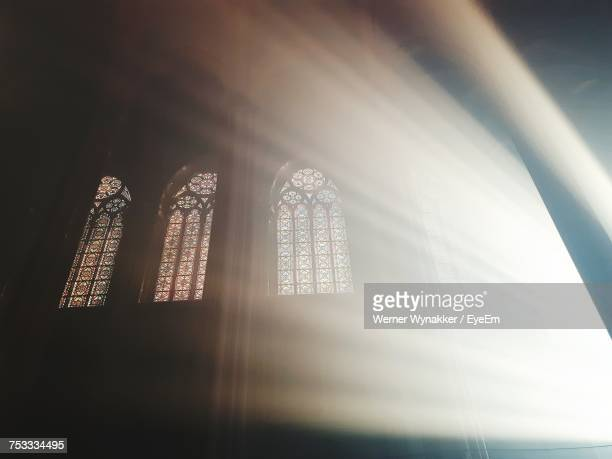 low angle view of window of temple - kirche stock-fotos und bilder