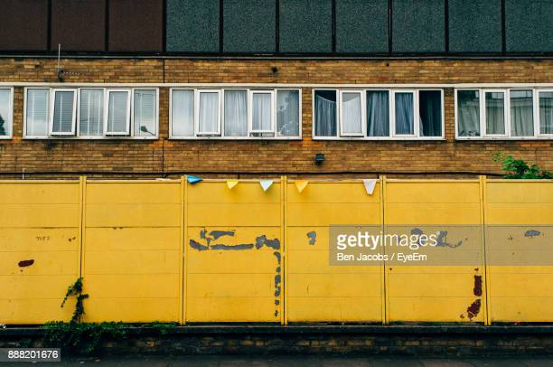 low angle view of windows on building - bethnal green stock pictures, royalty-free photos & images