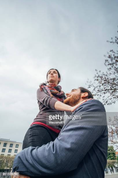 Low angle view of woman above businessman