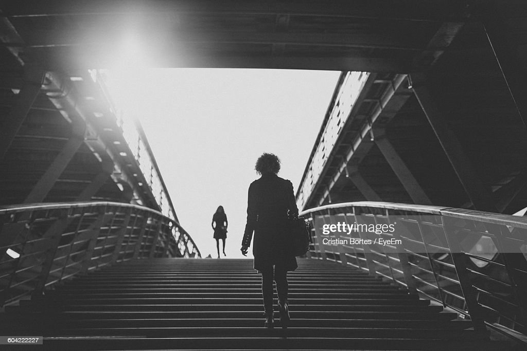 Low Angle View Of Woman Climbing Steps : Stock Photo