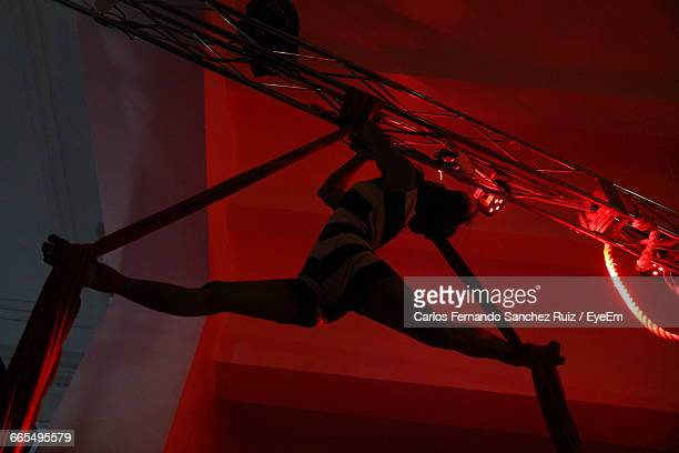 Low Angle View Of Woman Hanging On Fabric
