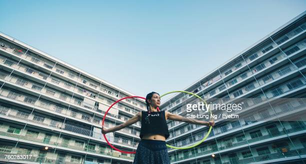 Low Angle View Of Woman Man Playing Against Clear Sky