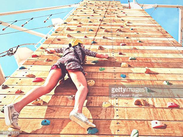 Low Angle View Of Woman On Climbing Wall