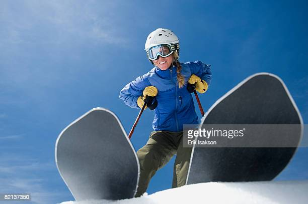 Low angle view of woman on skis