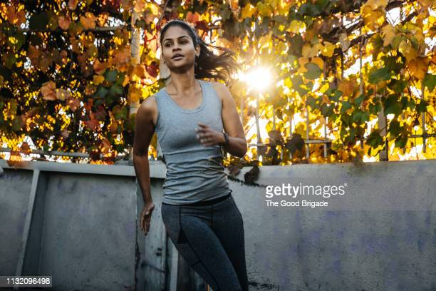Low angle view of woman running in park