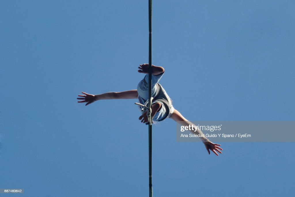 Low Angle View Of Woman Standing Cable Against Clear Sky : Stock Photo