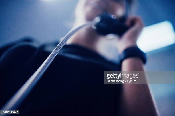 Low Angle View Of Woman Talking On Telephone