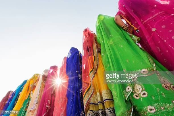 Low angle view of women wearing traditional multicolor saris