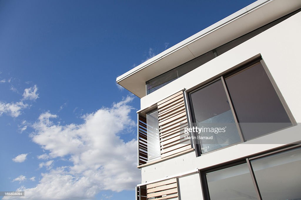 Low angle view of wood shutters on modern house : Stock Photo