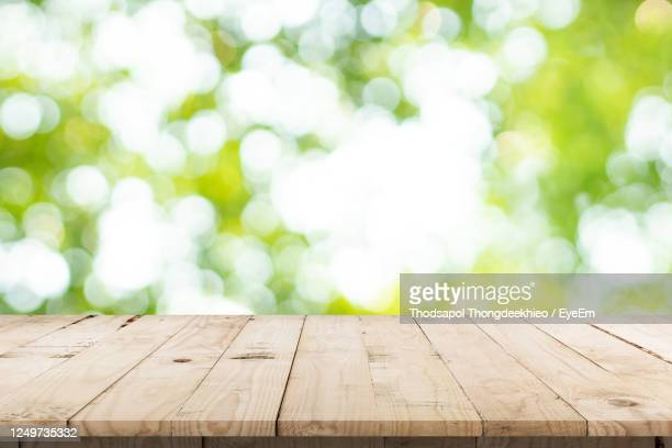 low angle view of wooden bench against sky - wood material photos et images de collection