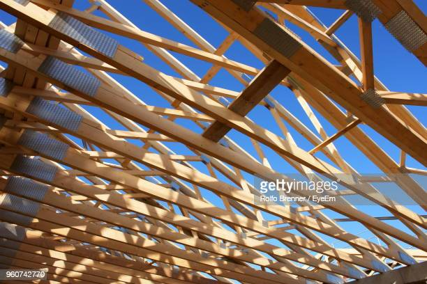 Low Angle View Of Wooden Ceiling Against Blue Sky