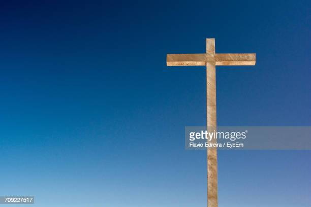 Low Angle View Of Wooden Cross Against Clear Blue Sky