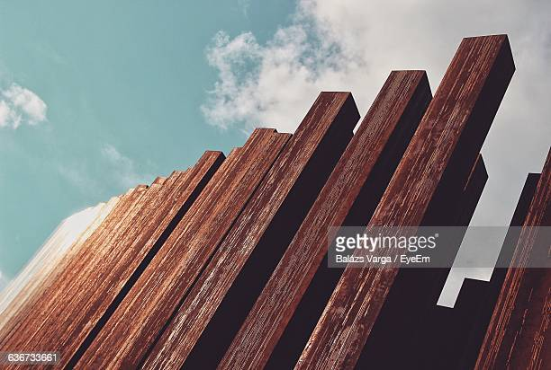 Low Angle View Of Wooden Fence