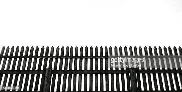 Low Angle View Of Wooden Picket Fence