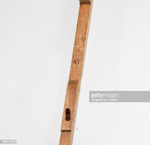 Low Angle View Of Wooden Stick Against White Background
