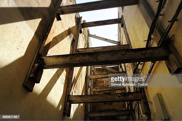 Low Angle View Of Wooden Structures Amidst Building